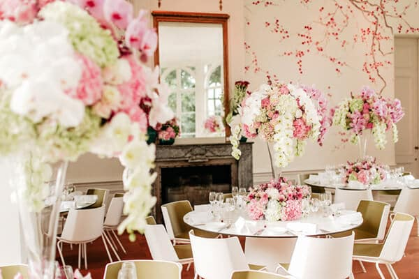 Tall wedding flower arrangements with phalaenopsis and low designs