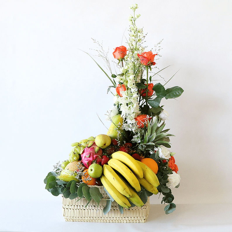 tropical fruit in a basket with flowers