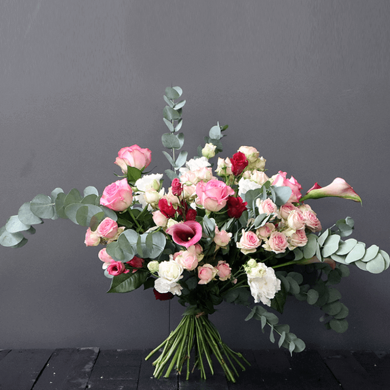 loose pink, white bouquet with calla lily, spray rose and eustoma