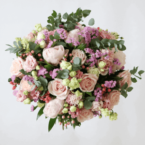 light pink roses with spray roses, eustoma and eucalyptus