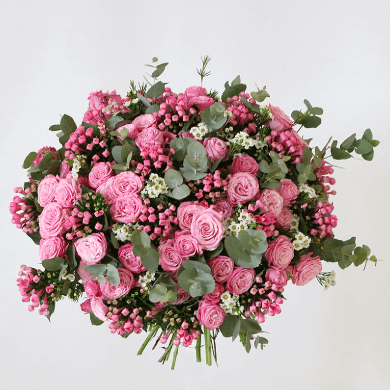 pink mixed spray roses with bouvadia in a bouquet