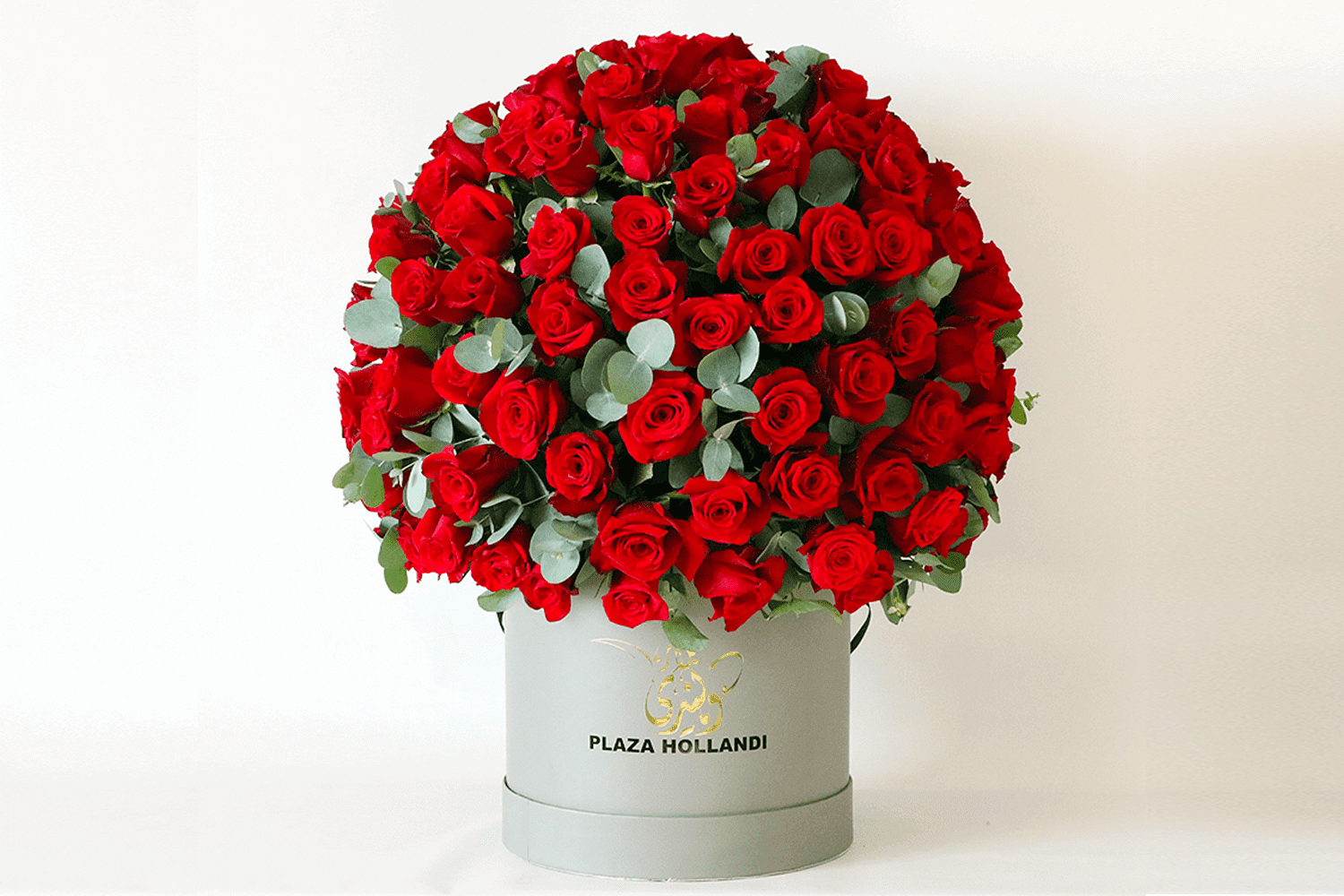 Valentine's Day Red roses and Eucalyptus in a plaza Hollandi hat box