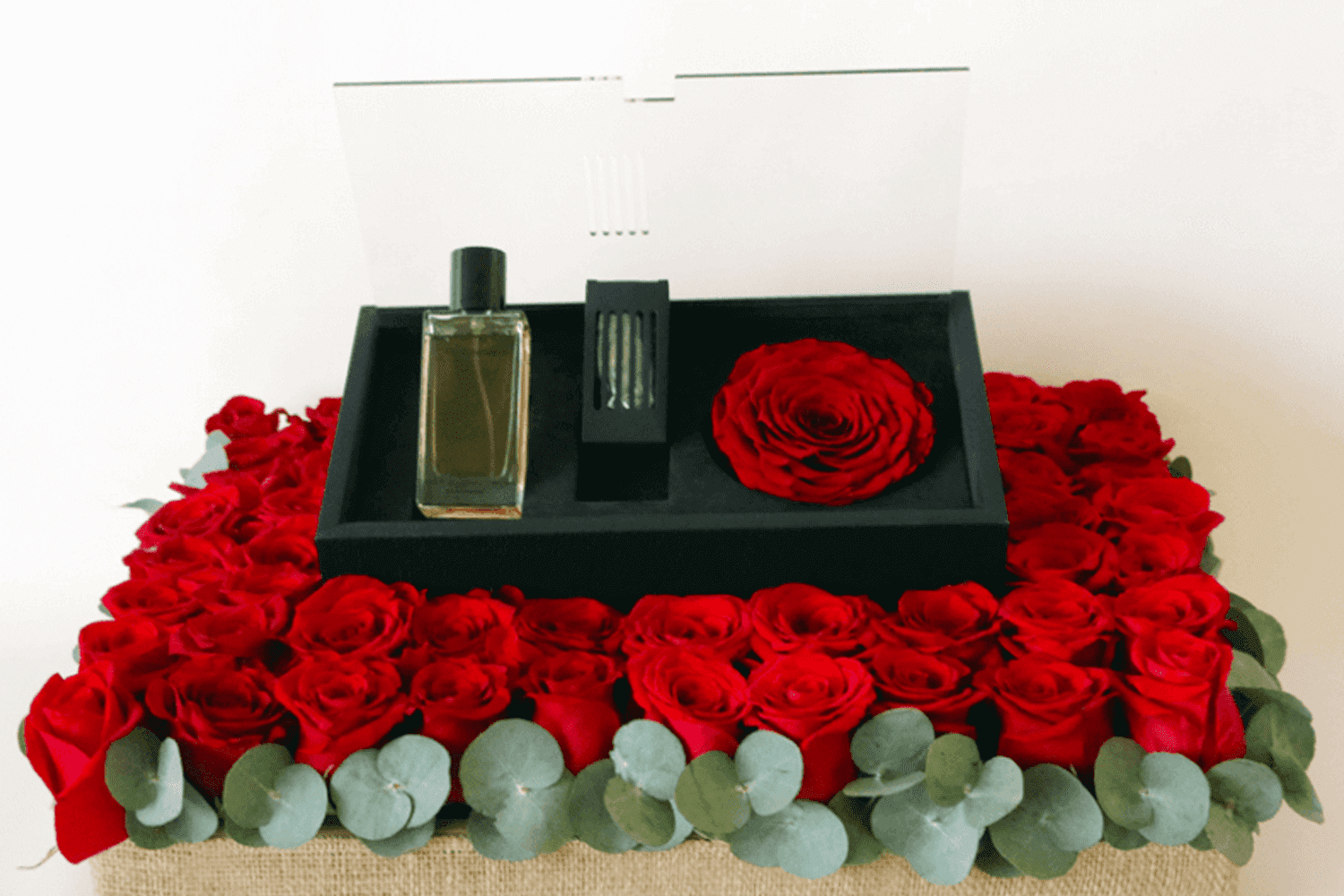 Revealing red perfume and red rose arrangement