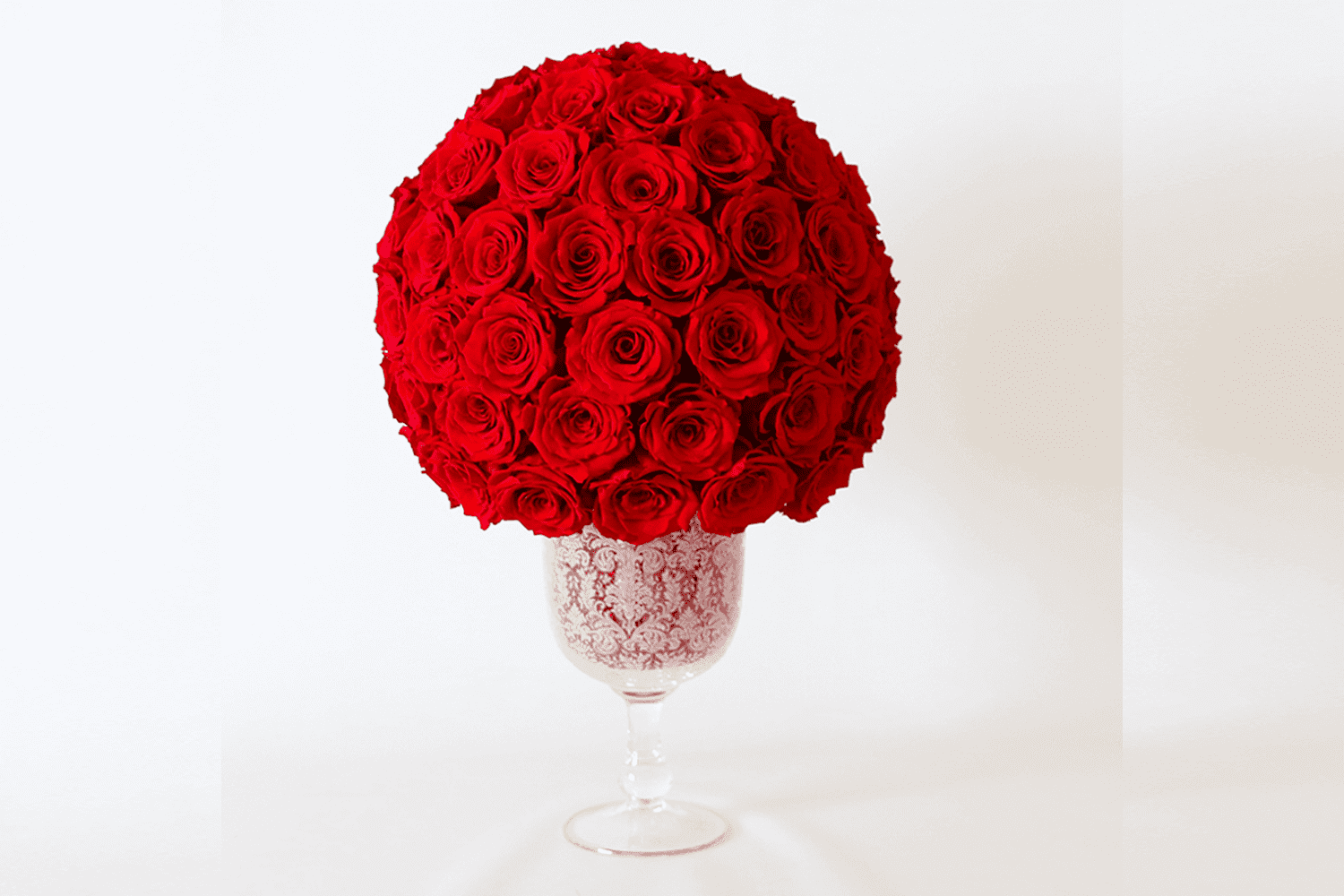 Red long lasting roses in a crystal vase
