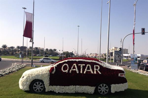 Car covered in flowers for national day