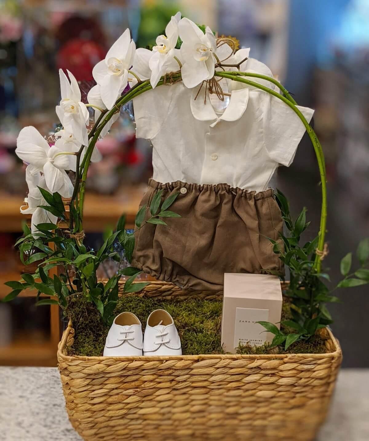 Basket arrangement with baby clothes