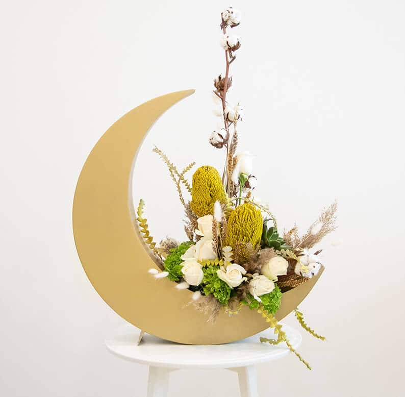 Crescent moon for Eid and Ramadan with roses and dried flowers