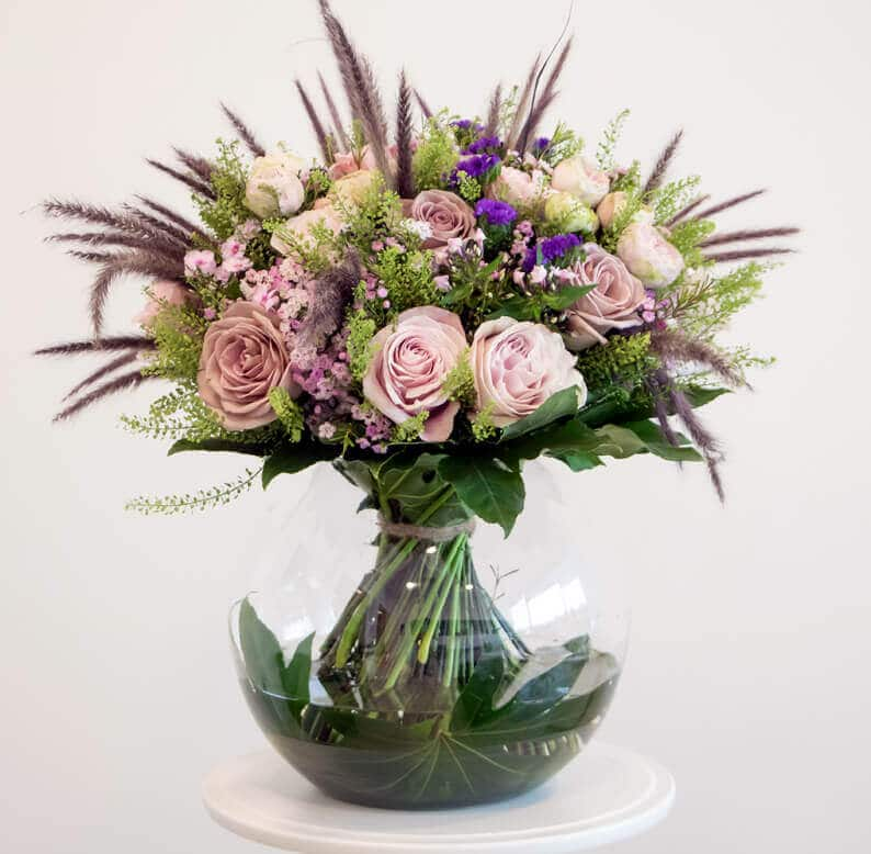 Pink and green bouquet in a vase