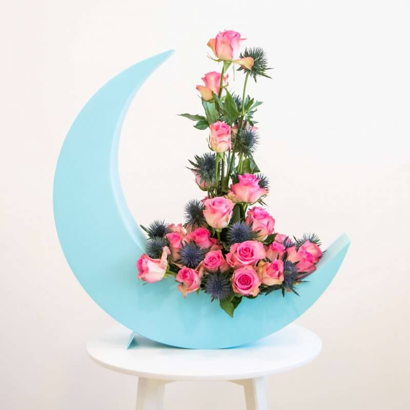 Crescent moon with pink flowers