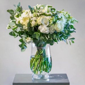 White and green bouquet in a vase