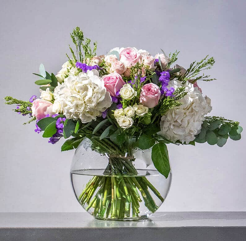 Pink, purple and white bouquet in a vase