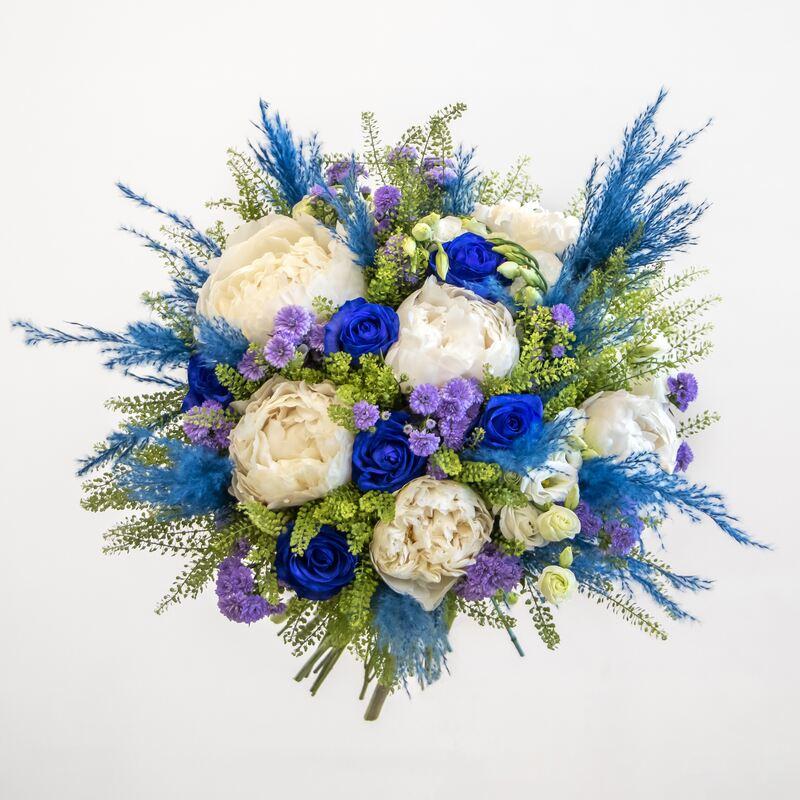 White peony, blue roses, purple statice, white eustoma with blue pampas grass