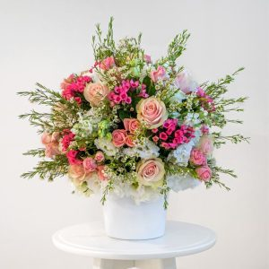 pink spray roses, white eustoma, wax flower, pink large headed roses and pink bouvadia