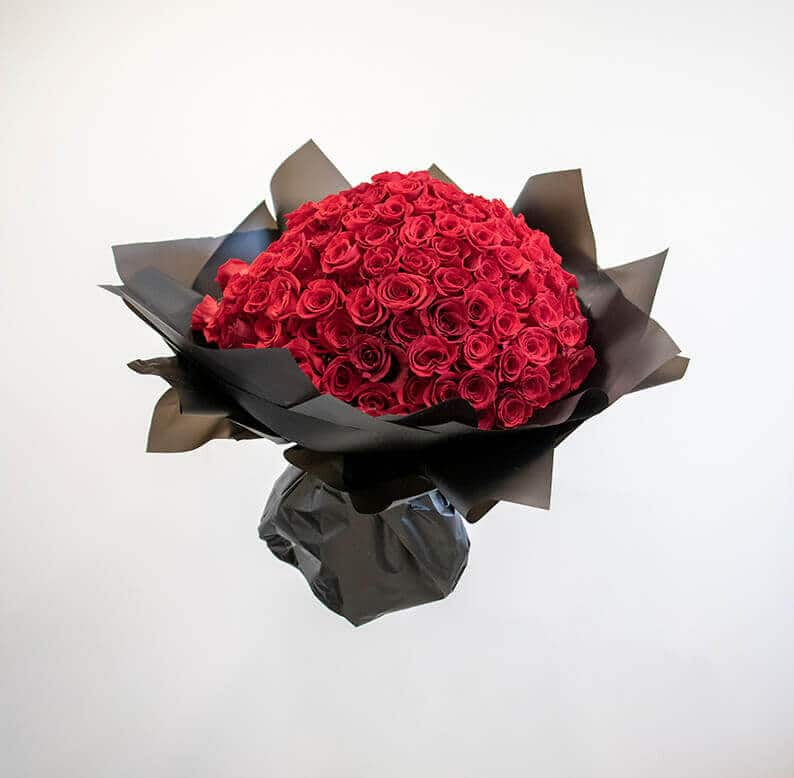 150 red roses wrapped in black paper