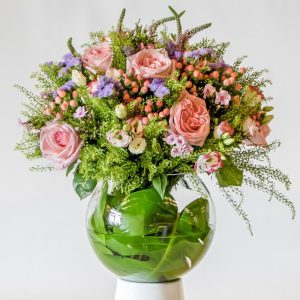 Pink and purple flower bouquet in a glass vase
