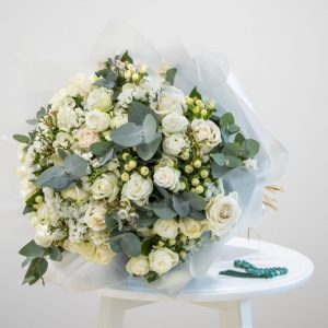 white and green bouquet with prayer beads