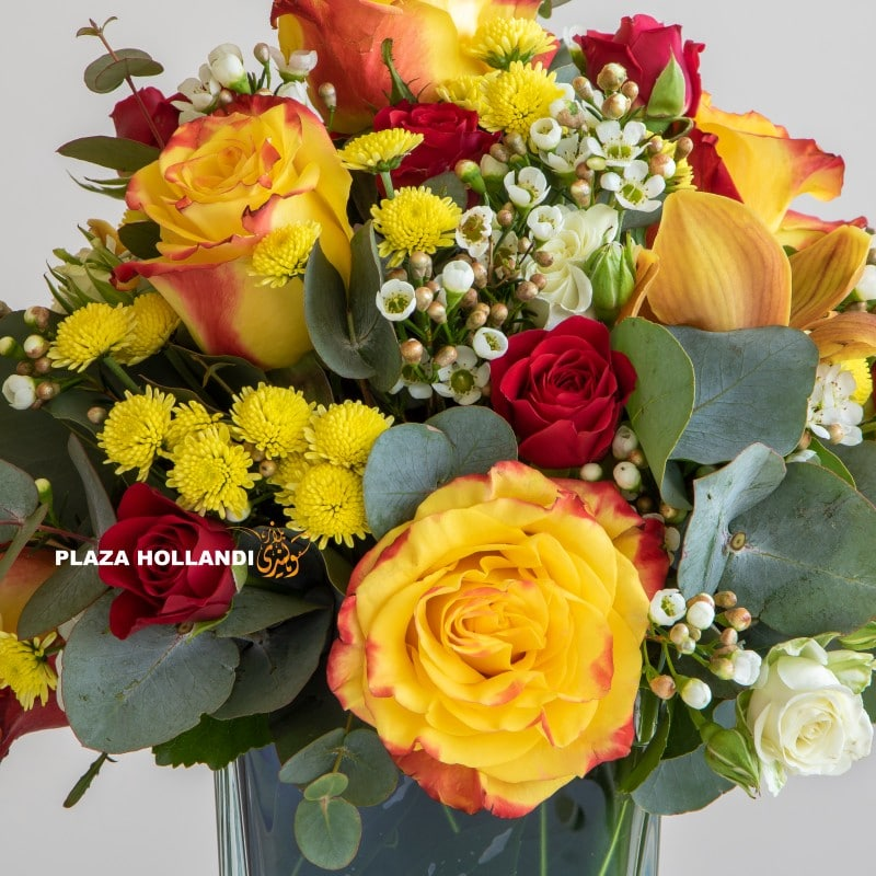 close up of yellow and red flower arrangement