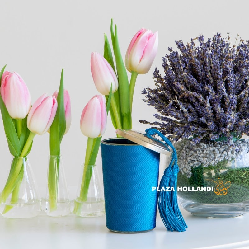 Close up of candles, tulips and lavender
