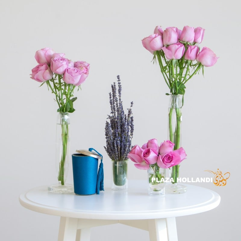 Pink spray roses with lavender and a candle