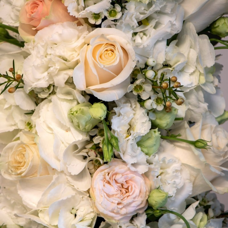 close up of hydrangea, eustoma, roses and wax flower