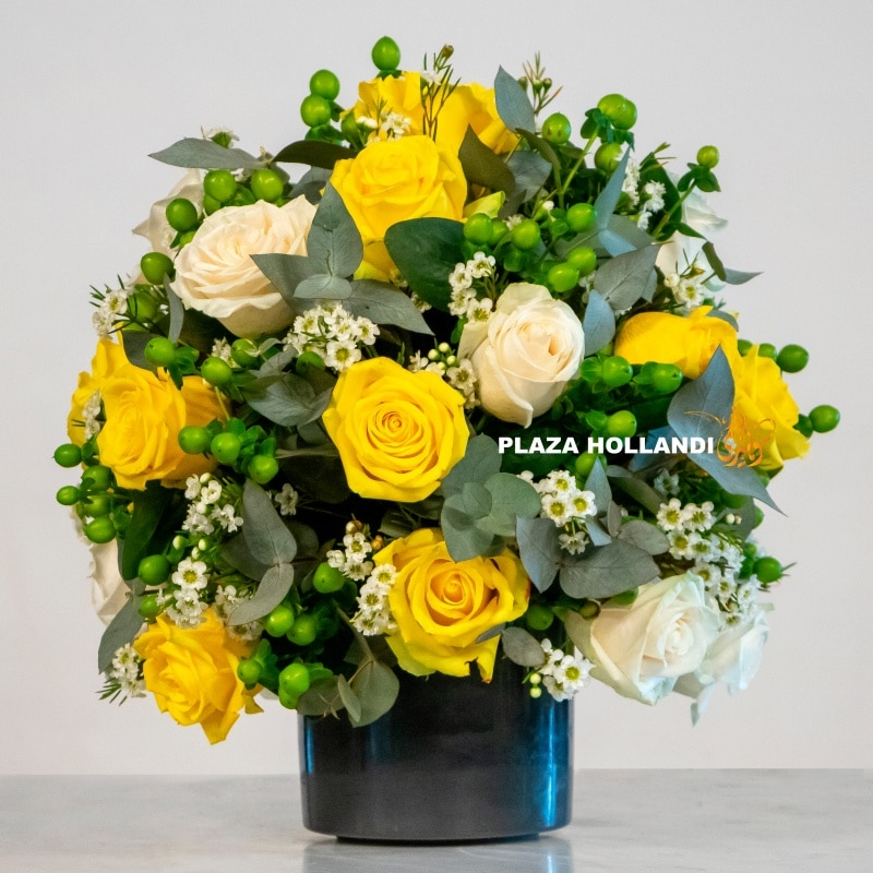 Yellow and white rose flower arrangement