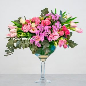 pink tulips, rose and statice in a flower arrangement