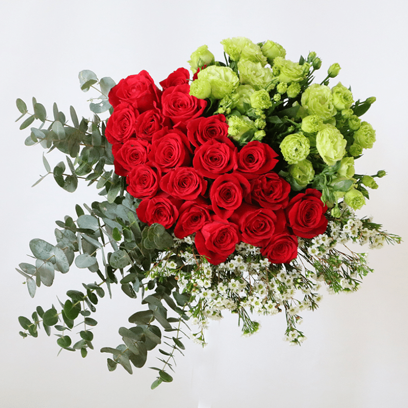 Red roses, green eustoma and eucalyptus in a bouquet