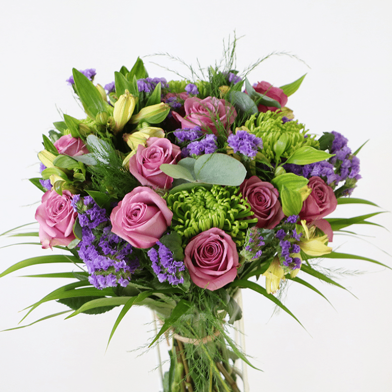 Purple roses with statice and chrysanthemums in a bouquet