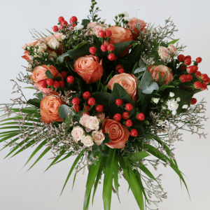 Orange roses, spray roses in a bouquet