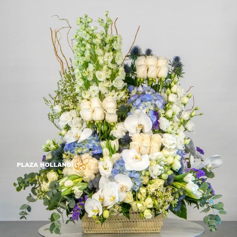 Blue, white and cream flower arrangement