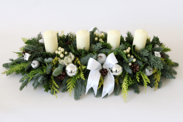 long and low white and green christmas arrangement