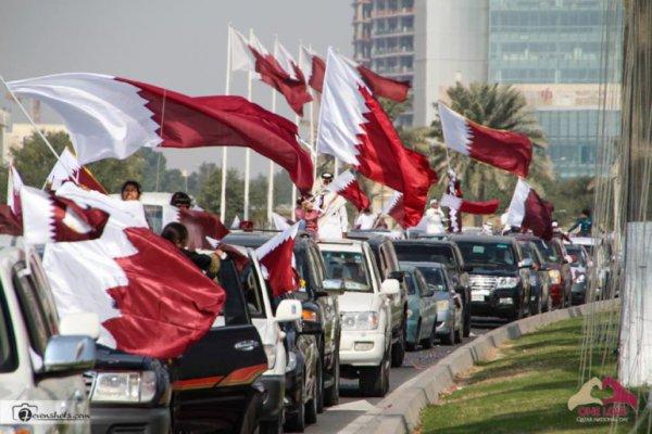 qatar national day parade with cars and qatari flag